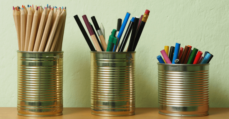 tins with pens and pencils