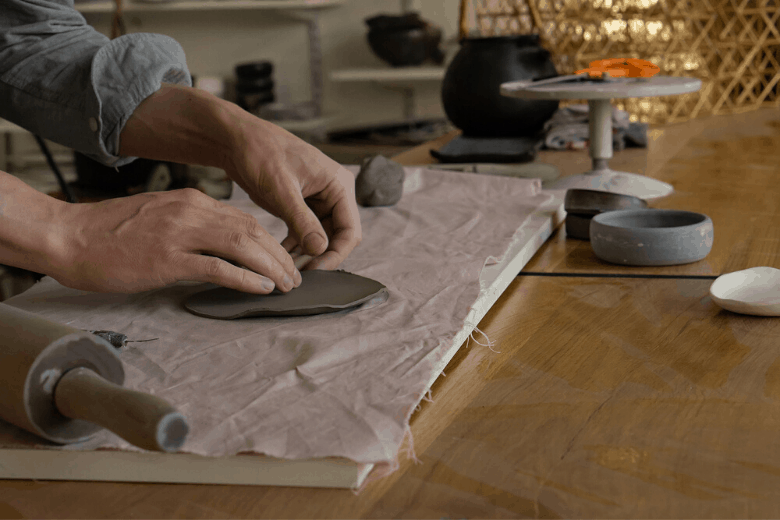 man working in ceramic workshop