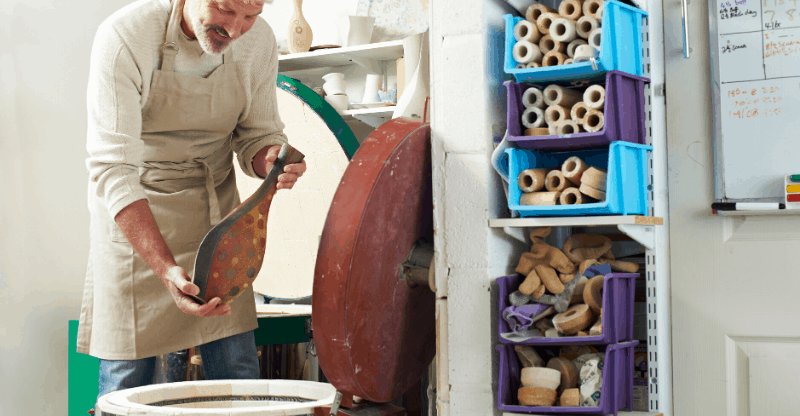 man working with kiln