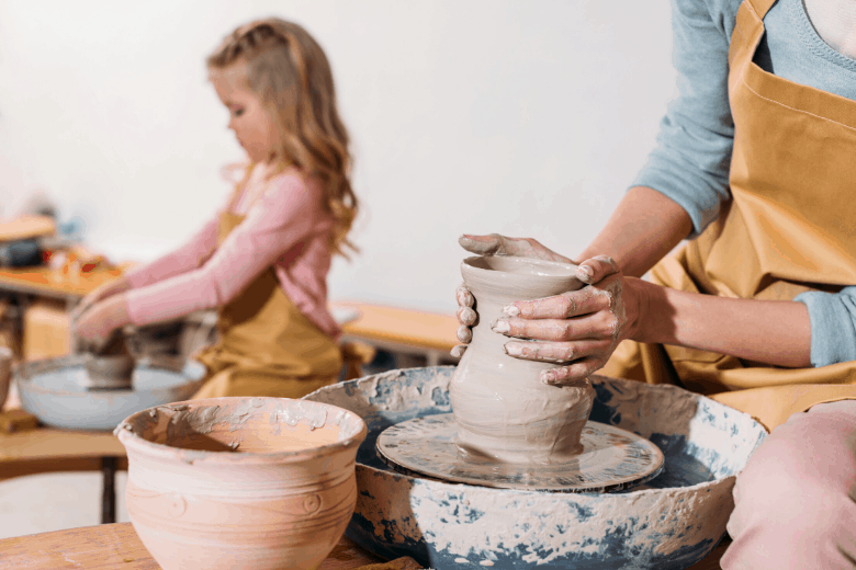 woman and child making pottery