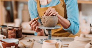 woman working with clay bowl